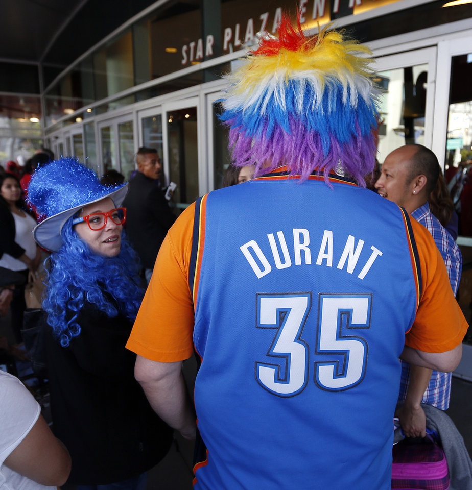 Photo - Sandra Manning and her husband, Ricky Manning, of Pauls Valley, Okla., wait to enter the arena before Game 3 of the Western Conference semifinals in the NBA playoffs between the Oklahoma City Thunder and the Los Angeles Clippers at the Staples Center in Los Angeles, Friday, May 9, 2014. Photo by Nate Billings, The Oklahoman