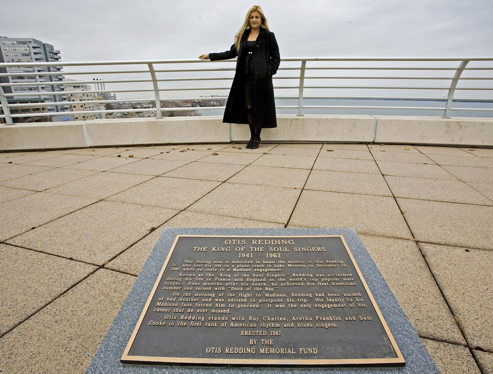 Photo - FILE - This Nov. 28, 2007 file photo shows Fran Puleo, manager of community relations for Monona Terrace, in front of an Otis Redding memorial plaque on top of Monona Terrace in Madison, Wis. The Frank Lloyd Wright-inspired Monona Terrace convention center rests on the shores of that lake, where Otis Redding died in a plane crash in 1967. There's a tough-to-find memorial plaque there that only the most dedicated music fans seek out.  (AP Photo/Morry Gash, File)