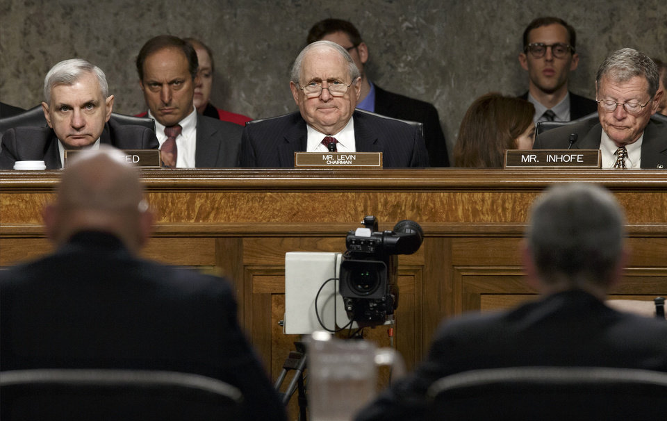 Photo - From left, Sen. Jack Reed, D-R.I., Senate Armed Services Committee Chairman Sen. Carl Levin, D-Mich., and the committee's ranking member, Sen. James Inhofe, R-Okla., listen as Army Chief of Staff Gen Raymond Odierno, lower left, and Army Secretary John M. McHugh, update the committee about the deadly shooting rampage by a soldier yesterday at Fort Hood in Texas, Thursday, April 3, 2014, on Capitol Hill in Washington. An Iraq War veteran being treated for mental illness was the gunman who opened fire at Fort Hood, killing three people and wounding 16 others before committing suicide, in an attack on the same Texas military base where more than a dozen people were slain in 2009.   (AP Photo/J. Scott Applewhite)
