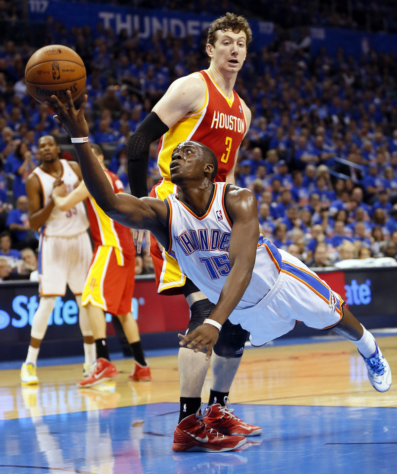 Photo - Oklahoma City's Reggie Jackson (15) takes a shot as he is fouled by Houston's Omer Asik (3) in the second half during Game 5 in the first round of the NBA playoffs between the Oklahoma City Thunder and the Houston Rockets at Chesapeake Energy Arena in Oklahoma City, Wednesday, May 1, 2013. Houston won, 107-100. Photo by Nate Billings, The Oklahoman