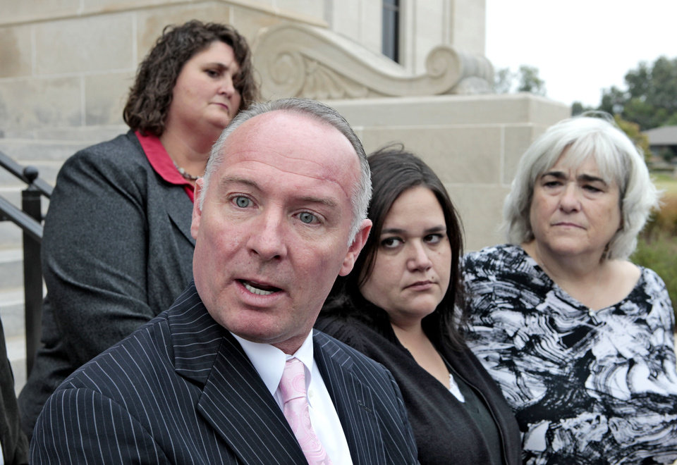 Photo - Danni Legg, who lost a son, Attorney David Slane, Kristi Conatzer, who lost her daughter in the Moore School tornado, and Kathy Turner  at a press conference after a hearing at the State Supreme Court on the storm shelters initiative, October 27, 2013. Photo by David McDaniel, The Oklahoman