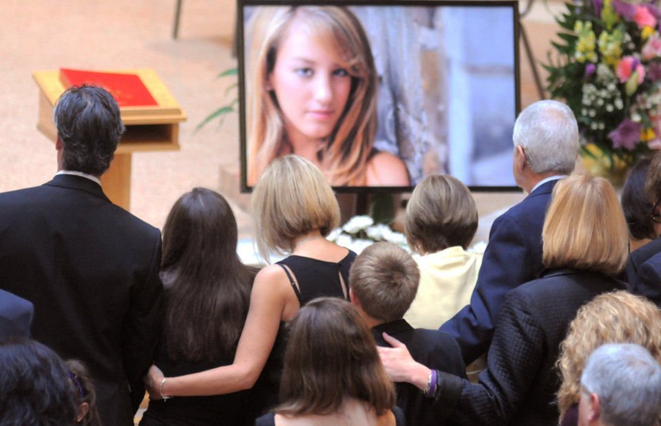 Family members of Alexandra Kogut attend her funeral at St. John the Evangelist Church, Thursday, Oct. 4, 2012, in New Hartford, N.Y. Kogut's body was found early Saturday in her dorm room at the State University of New York College at Brockport, near Rochester. Her boyfriend Clayton Whittemore, of New Hartford, is charged with the killing. (AP Photo/Observer-Dispatch, Mark DiOrio, Pool)