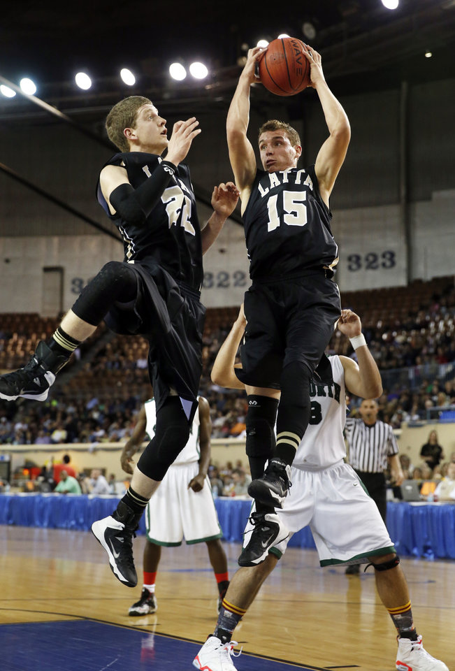 Photo - Latta's Kade Hayes (15) rebounds and Brogan Catrell watches as the Haworth Lions play the Latta Panthers in the finals of the State Class 2A Boys Basketball Tournament at the Fairgrounds Arena on Saturday, March 15, 2014, in Oklahoma City, Okla. Photo by Steve Sisney, The Oklahoman