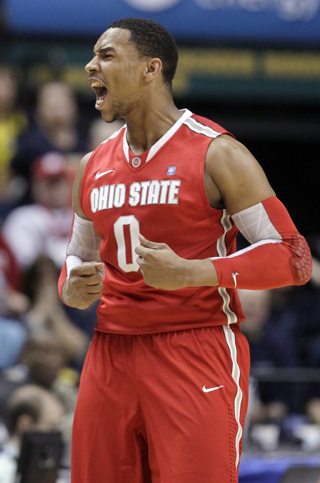Photo -   Ohio State forward Jared Sullinger (0) reacts in the first half of an NCAA college basketball game against Michigan in the semifinals of the Big Ten Conference tournament in Indianapolis, Saturday, March 10, 2012. (AP Photo/Michael Conroy)