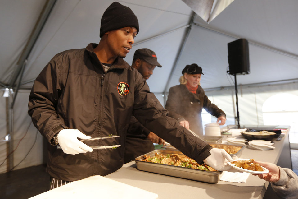 Iguana Mexican Grill Chef Tony Softley puts forward food on the Culinary Arts Demonstration Stage. <strong>Steve Gooch - The Oklahoman</strong>