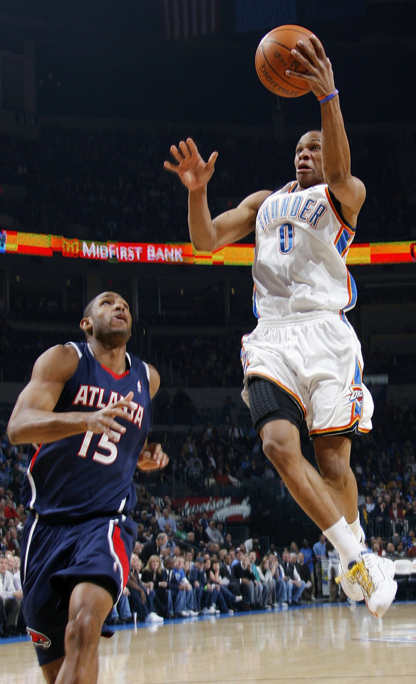 Oklahoma City's Russell Westbrook (0) moves to the hoop around Al Horford (15) of Atlanta during the NBA basketball game between the Atlanta Hawks and the Oklahoma City Thunder at the Ford Center in Oklahoma City, Tuesday, February 2, 2010. Photo by Nate Billings, The Oklahoman