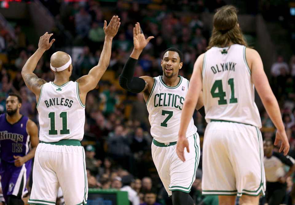 Photo - Boston Celtics center Jared Sullinger (7) celebrates with teammates Jerryd Bayless (11) and Kelly Olynyk (41) after scoring during the second half of an NBA basketball game against the Sacramento Kings, Friday, Feb. 7, 2014, in Boston. Sullinger scored 31 points and the Celtics won 99-89. (AP Photo/Mary Schwalm)