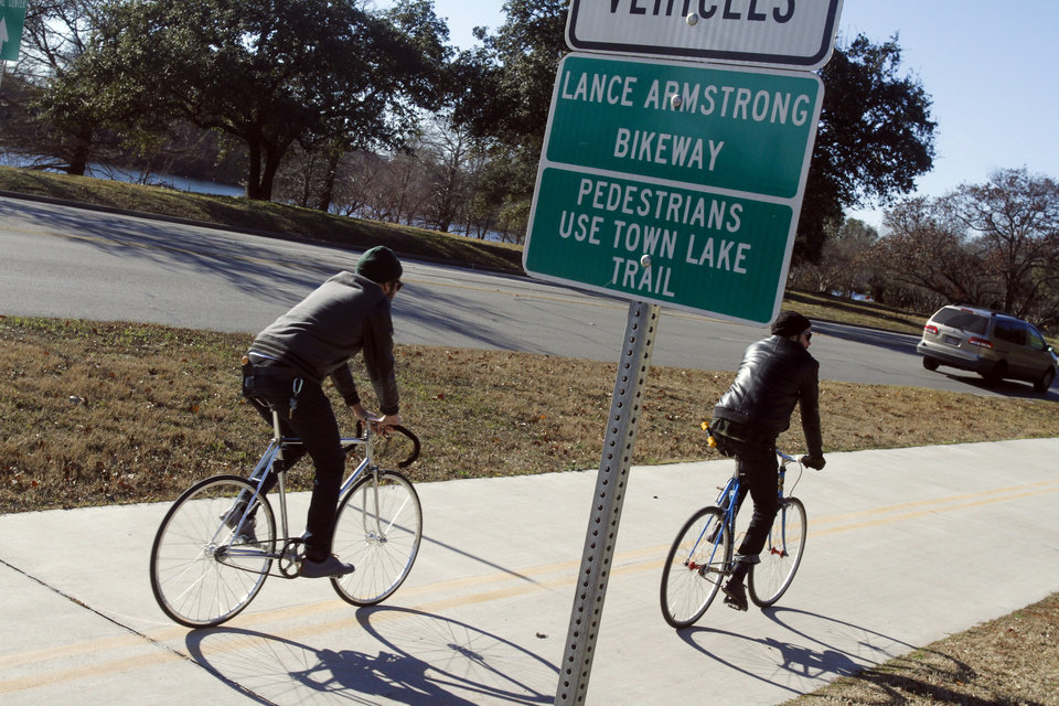 Photo - Cyclists rides along the Lance Armstrong Bikeway, Sunday, Jan. 13, 2013, in Austin, Texas. In what's been billed as a