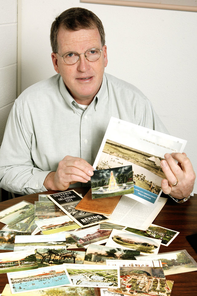 Brian Dougherty, Parks & Public Spaces Initiative staff member at the Oklahoma City Community Foundation, with a few of his postcards of early day Okla. City parks in Okla. City Friday, Feb. 2, 2007. Brian is holding photos of Memorial Park, the larger one is of Putnam Lake Park and the smaller one is Memorial Park after Putnam was renamed Memorial and the fountain put in. BY PAUL B. SOUTHERLAND, The Oklahoman