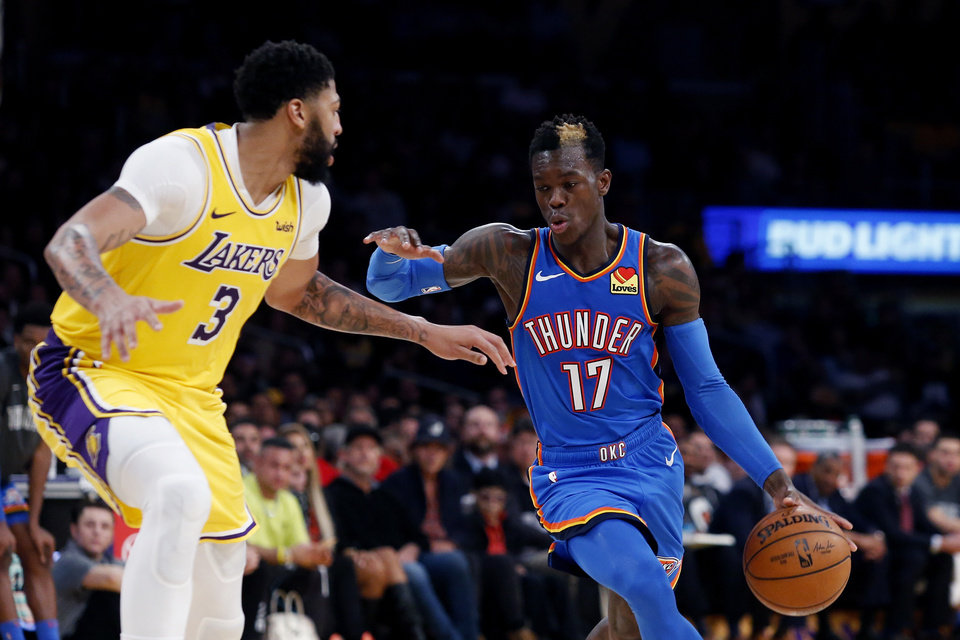Photo - Oklahoma City Thunder's Dennis Schroeder (17) drives against Los Angeles Lakers' Anthony Davis (3) during the second half of an NBA basketball game Tuesday, Nov. 19, 2019, in Los Angeles. The Lakers won 112-107. (AP Photo/Ringo H.W. Chiu)
