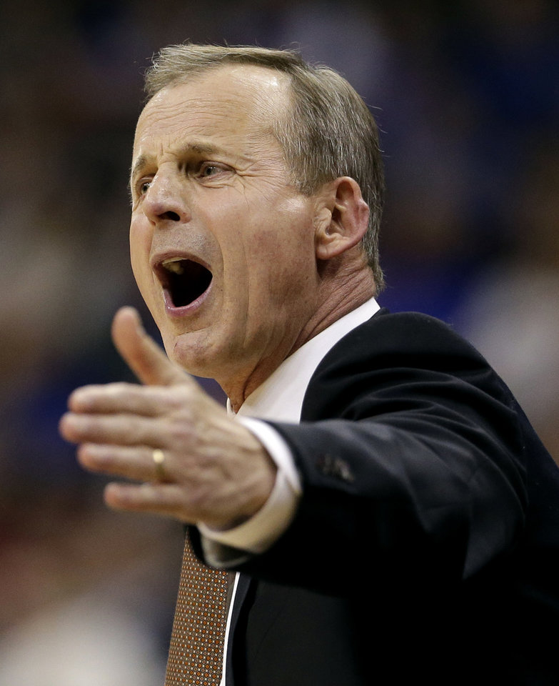 Photo - Texas coach Rick Barnes questions a call during the first half of an NCAA college basketball game against Baylor in the semifinals of the Big 12 Conference tournament on Friday, March 14, 2014, in Kansas City, Mo. (AP Photo/Charlie Riedel)