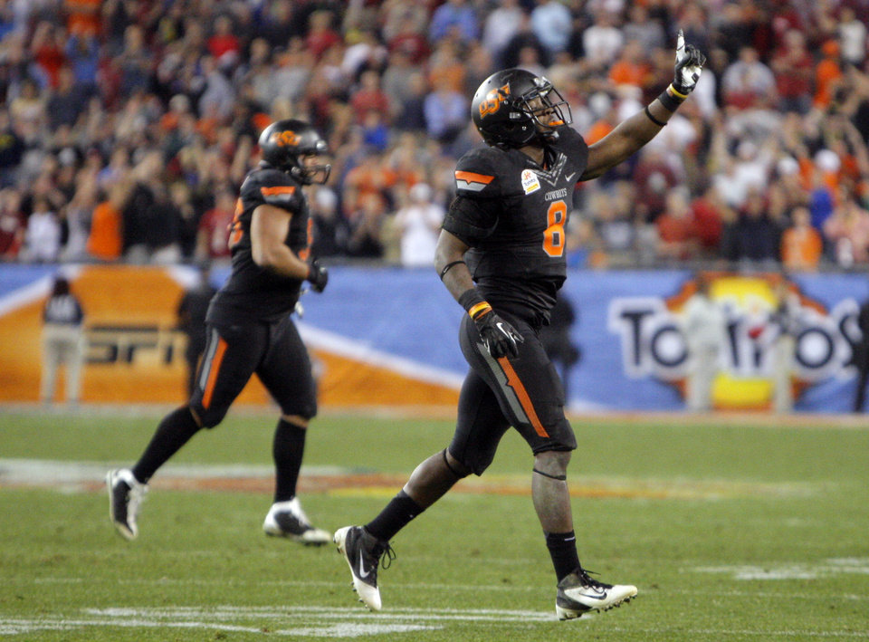 Photo - Oklahoma State's Daytawion Lowe (8) celebrates a missed Stanford field goal in overtime during the Fiesta Bowl between the Oklahoma State University Cowboys (OSU) and the Stanford Cardinal at the University of Phoenix Stadium in Glendale, Ariz., Tuesday, Jan. 3, 2012. Photo by Sarah Phipps, The Oklahoman