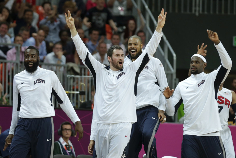 Photo -   USA's Kevin Love raises his arms as he celebrates after a 3-pointer by teammate Carmelo Anthony during a men's basketball game against Nigeria at the 2012 Summer Olympics, Thursday, Aug. 2, 2012, in London. (AP Photo/Charles Krupa)