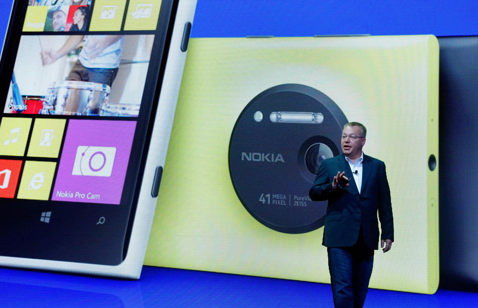 Photo - Nokia CEO Stephen Elop desicribes his company's Nokia Lumia 1020, in New York,  Thursday, July 11, 2013. The Nokia Lumia 1020, with a 41-megapixel camera, records more detail than other camera phones and even tops point-and-shoot cameras. (AP Photo/Richard Drew)