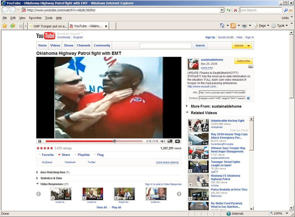 Top: An image from a video showing the scuffle  posted on YouTube by the son of the patient inside the ambulance.