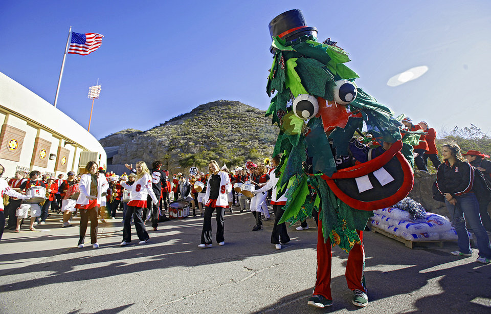 Photo - The Stanford Tree mascot dances with the band as they perform outside the stadium before the Brut Sun Bowl college football game between the University of Oklahoma Sooners (OU) and the Stanford University Cardinal on Thursday, Dec. 31, 2009, in El Paso, Tex.   Photo by Chris Landsberger, The Oklahoman
