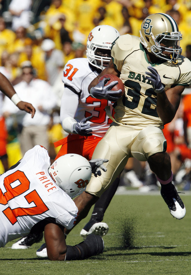 Photo - Jermiah Price tackles Jay Finley (32) during the second half of the college football game between Baylor University and Oklahoma State University (OSU) at Floyd Casey Stadium in Waco, Texas, on Saturday, Oct. 24, 2009.  Photo by Steve Sisney, The Oklahoman