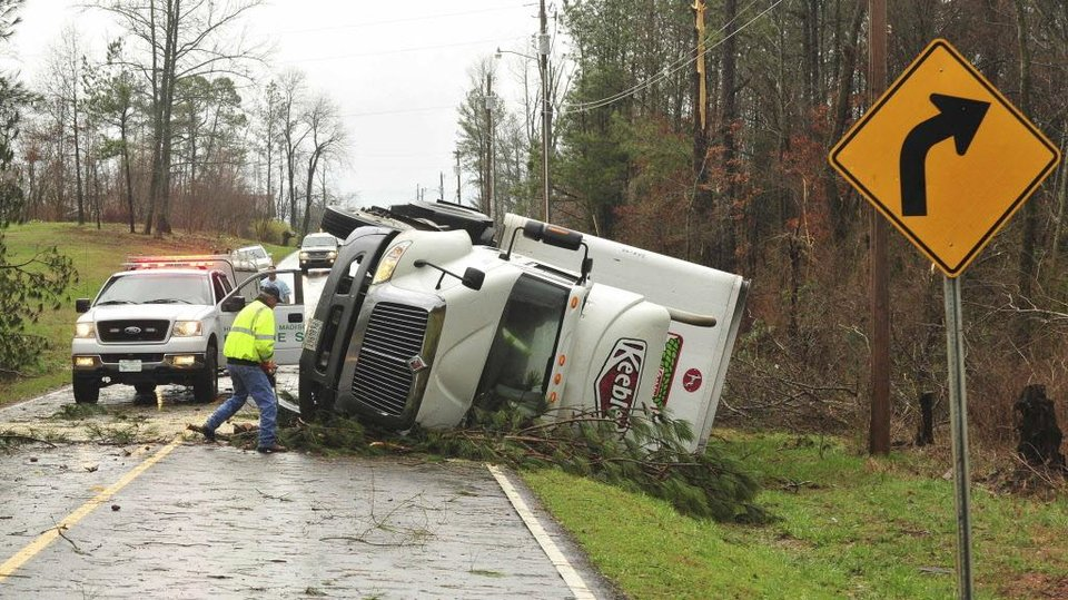 A 18-wheeler is  flipped on it's side on Friday morning March 2, 2012 in Harvest, Ala. A reported tornado destroyed several houses in northern Alabama as storms threatened more twisters across the region Friday.   (AP Photo/The Huntsville Times, Eric Schultz) ORG XMIT: ALHUT110