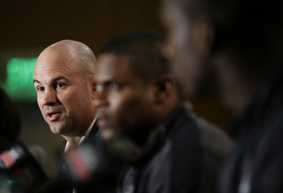 Photo - Florida State defensive coordinator Jeremy Pruitt, left, speaks as he is joined by cornerback Lamarcus Joyner, center, and linebacker Telvin Smith during a news conference on Thursday, Jan. 2, 2014, in Newport Beach, Calif. Florida State is scheduled to play Auburn on Monday, Jan. 6, in the BCS national championship NCAA college football game. (AP Photo/Jae C. Hong)