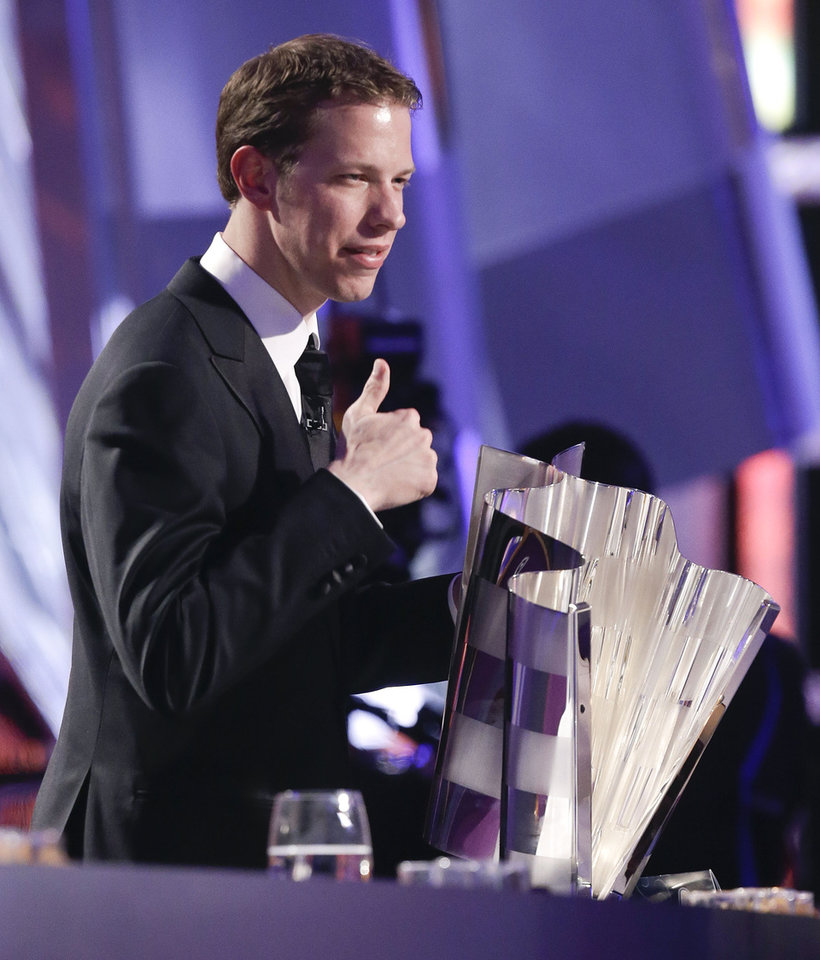 Brad Keselowski poses for a television camera with his trophy during season-ending NASCAR awards ceremony after accepting the award for winning the NASCAR Sprint Cup Series Championship, Friday, Nov. 30, 2012 in Las Vegas. (AP Photo/Julie Jacobson)