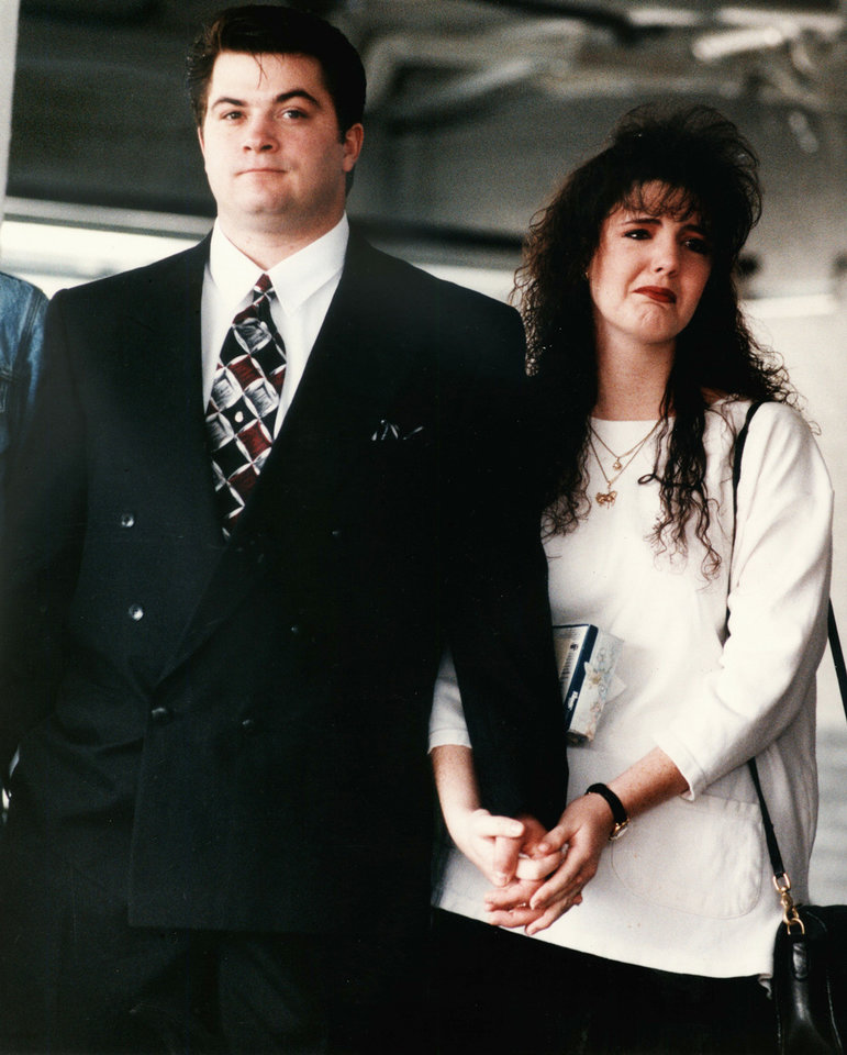 Photo - James Jarman and his wife, Alicia, were among mourners at the funeral Dec. 15, 1993, for Jarman's two children, Tonya, 5, and Timothy, 3, and their mother, Cynthia Lynn Jarman, 23. The three victims were found shot to death.  Photo by Steve Sisney, The Oklahoman Archives