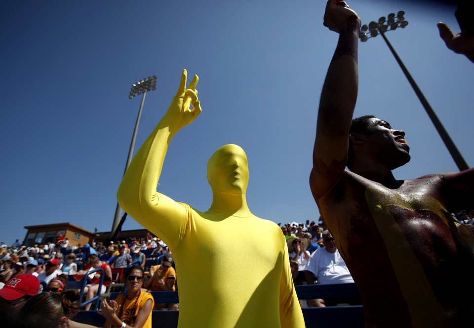 Photo - Arizona State fans Eric Beeler,left, and Ben Boulware cheer during the Women's College World Series game between Arizona State and Baylor at the ASA Hall of Fame Stadium in Oklahoma City, Sunday, June 5, 2011. Photo by Sarah Phipps, The Oklahoman