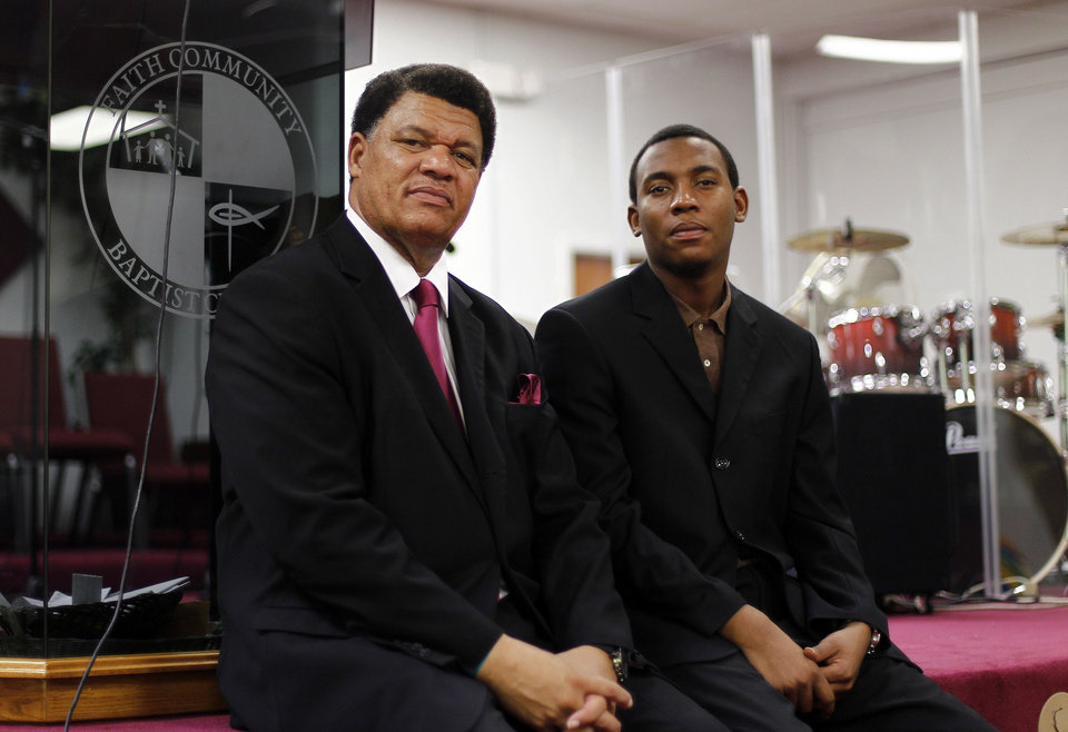Photo -   Rev. Richard Dunn, left, and his son, Rev. Richard Dunn III, are seen in Miami, Tuesday, Oct. 2, 2012, as they discuss their plans to motivate church members to vote in the upcoming elections. It's not just the collection plate that's getting passed around this fall at hundreds of mainly African-American and Latino churches in presidential battleground states and across the nation. Exhorting congregations to register to vote, church leaders are distributing registration cards in the middle of services, and many are pledging caravans of