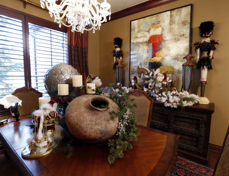 Photo - Mike and Debbie McCurdy's dining room is decorated for the holidays. The McCurdy home is one of five on the Assistance League of Norman's Holiday Home Tour. PHOTO BY STEVE SISNEY, THE OKLAHOMAN  STEVE SISNEY