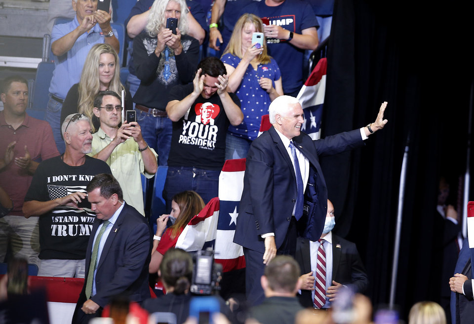 Photo - Vice President Mike Pence waves as he enters the arena during the President Donald Trump rally at the BOK Center in Tulsa, Okla., Saturday, June 20, 2020. [Sarah Phipps/The Oklahoman]