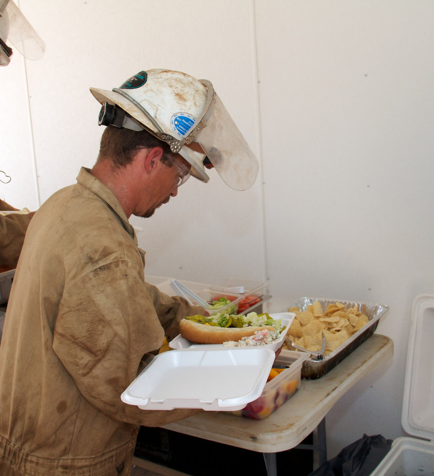 Photo - Oilfield worker Quintin Manning enjoys a deli bar onsite at a well near Sweetwater. The meal was prepared by Erick-based Somekinda Catering, which provides food to oilfield workers throughout western Oklahoma and the Texas panhandle.  photo by Adam Wilmoth