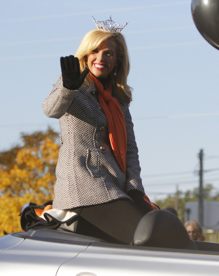 Photo - Miss OSU Aly Akers waves to OSU fans during the Oklahoma State Cowboy's homecoming parade in downtown Stillwater, OK, Saturday, Oct. 29, 2011. By Paul Hellstern, The Oklahoman