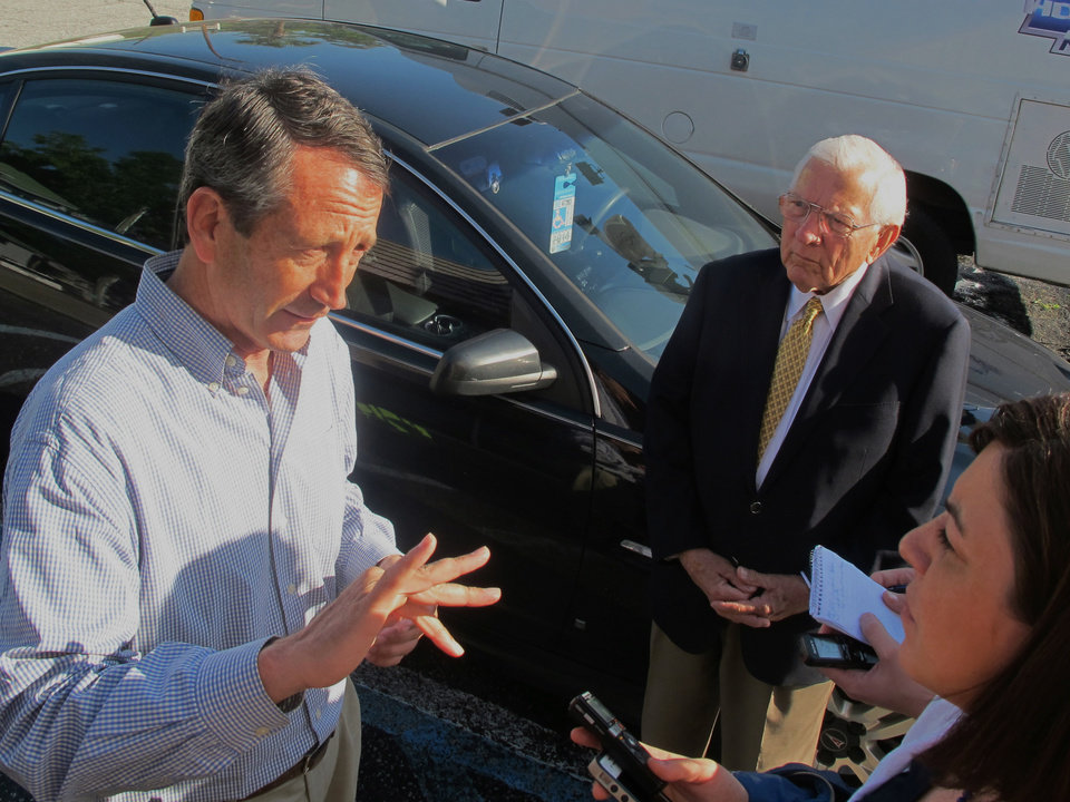 Mark Sanford speaks with a reporter as former S.C. Gov. Jim Edwards looks on during a campaign stop at a diner in Mount Pleasant, S.C., on Monday, May 6, 2012. Sanford faces Elizabeth Colbert Busch, the sister of comedian Stephen Colbert, in a special congressional election in the state\'s 1st District on Tuesday. (AP Photo/Bruce Smith)