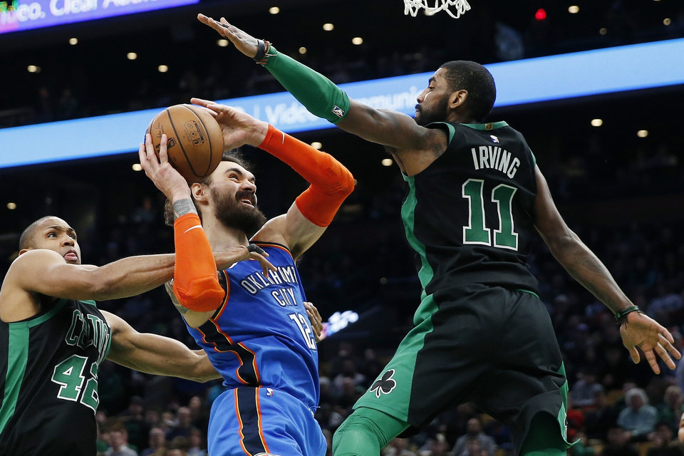Photo - Boston Celtics' Al Horford (42) and Kyrie Irving (11) double-team Oklahoma City Thunder's Steven Adams (12) during the second half of an NBA basketball game in Boston, Sunday, Feb. 3, 2019. (AP Photo/Michael Dwyer)