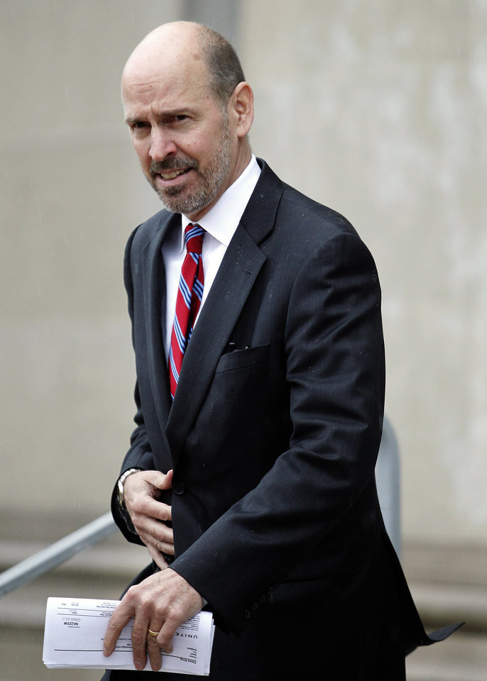 Photo -   Scott Thomas makes his way out of a federal courthouse in Greensboro, N.C., during the trial of former presidential candidate and U.S. Sen .John Edwards, Monday, May 14, 2012. Edwards has pleaded not guilty to six criminal counts related to campaign finance violations. (AP Photo/Bob Leverone)