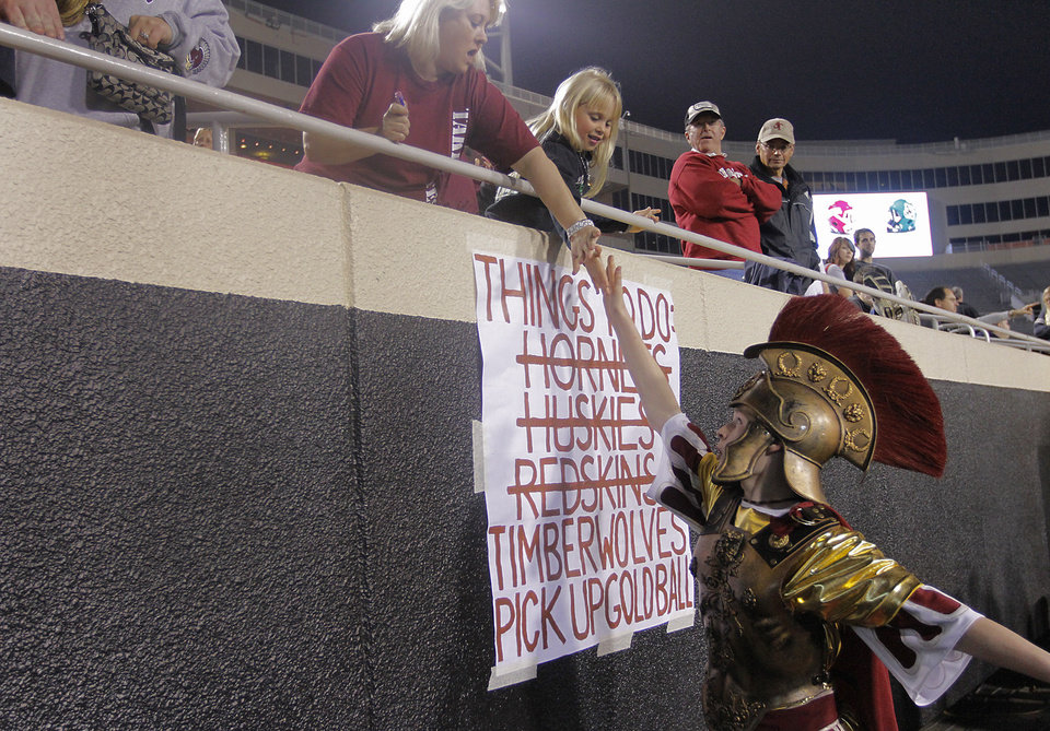 Jenks' mascot Steven Blunk gives high five's to fans during the Class 6A Oklahoma state championship football game between Norman North High School and Jenks High School at Boone Pickens Stadium on Friday, Nov. 30, 2012, in Stillwater, Okla.   Photo by Chris Landsberger, The Oklahoman
