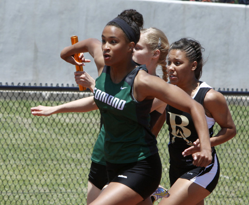 Edmond Santa Fe's Ashley Ehrhart takes the handoff from teammate Emily Hart in the girl's 6A 4 X 100 relay during the 5A and 6A State Track Meet in Yukon, OK, Saturday, May 11, 2013. The team took third place.  By Paul Hellstern, The Oklahoman