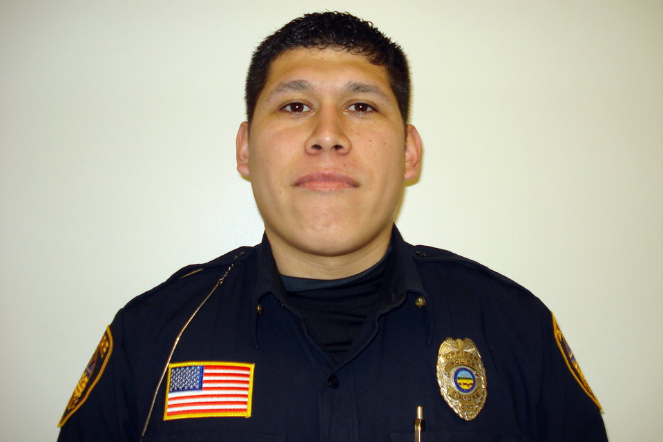 Photo - In this undated photo provided by Elmore police, officer Jose Andy Chavez is shown. Chavez was one of the three men killed in a shooting at the Last Call Bar in Fremont, Ohio, Sunday, March 9, 2014. No arrest has been made, and detectives are working to identify the gunman. (AP Photo/Elmore Police)