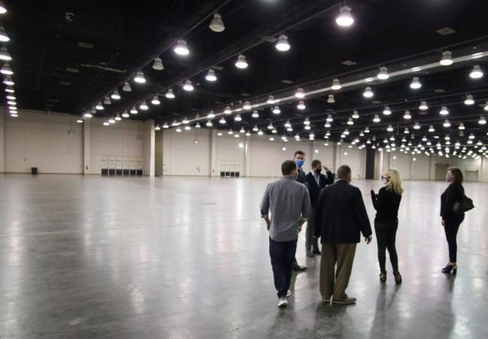 Photo -  Prairie Surf Media, owned by Rachel Cannon and Matt Payne, discuss a proposed conversion of the Cox Center into a space to be used for sound stages and film production during a tour with a group led by Mayor David Holt. [DOUG HOKE/THE OKLAHOMAN]