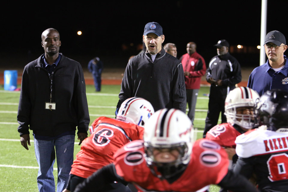 Photo - Bill Cowher watches at a clinic at Southmoore High school for two teams from the Oklahoma Elite Football League Wednesday, November 20, 2013. Photo by Doug Hoke, The Oklahoman