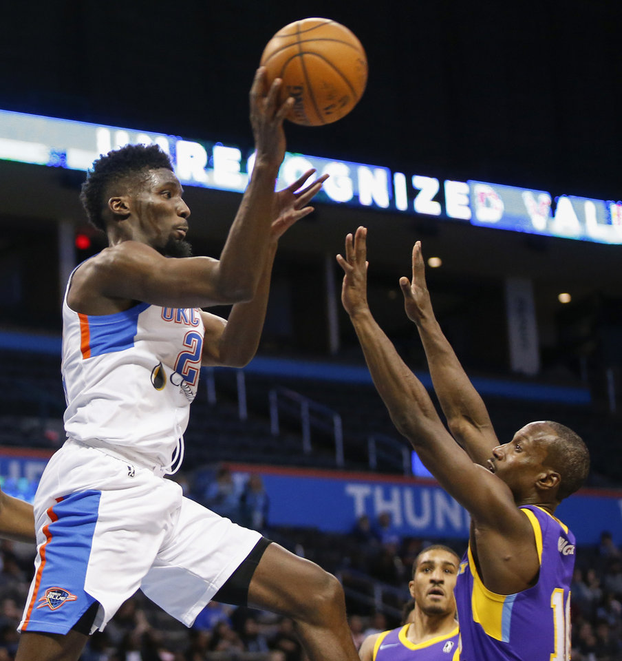 Photo - Oklahoma City's Daniel Hamilton (25) passes over South Bay's Andre Ingram (10) during an NBA G League playoff game between the Oklahoma City Blue and the South Bay Lakers at Chesapeake Energy Arena in Oklahoma City, Saturday, March 31, 2018. Photo by Nate Billings, The Oklahoman