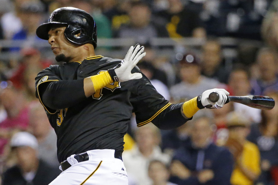 Photo - Pittsburgh Pirates' Jose Tabata drives in the tying run with a sacrifice fly off Washington Nationals starting pitcher Stephen Strasburg during the seventh inning of a baseball game in Pittsburgh, Saturday, May 24, 2014. (AP Photo/Gene J. Puskar)