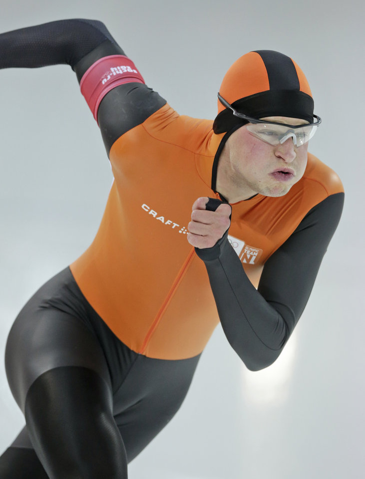 Photo - Sven Kramer of the Netherlands takes the start on his way to a new Olympic record in the men's 5,000-meter speedskating race at the Adler Arena Skating Center at the 2014 Winter Olympics in Sochi, Russia, Saturday, Feb. 8, 2014. (AP Photo/Matt Dunham)
