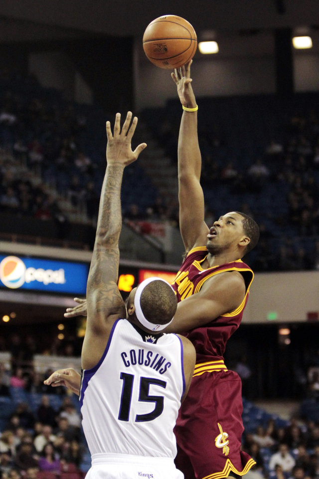 Cleveland Cavaliers forward Tristan Thompson, right, shoots over Sacramento Kings center DeMarcus Cousins during the first quarter of an NBA basketball game in Sacramento, Calif., Monday, Jan. 14, 2013. (AP Photo/Rich Pedroncelli)
