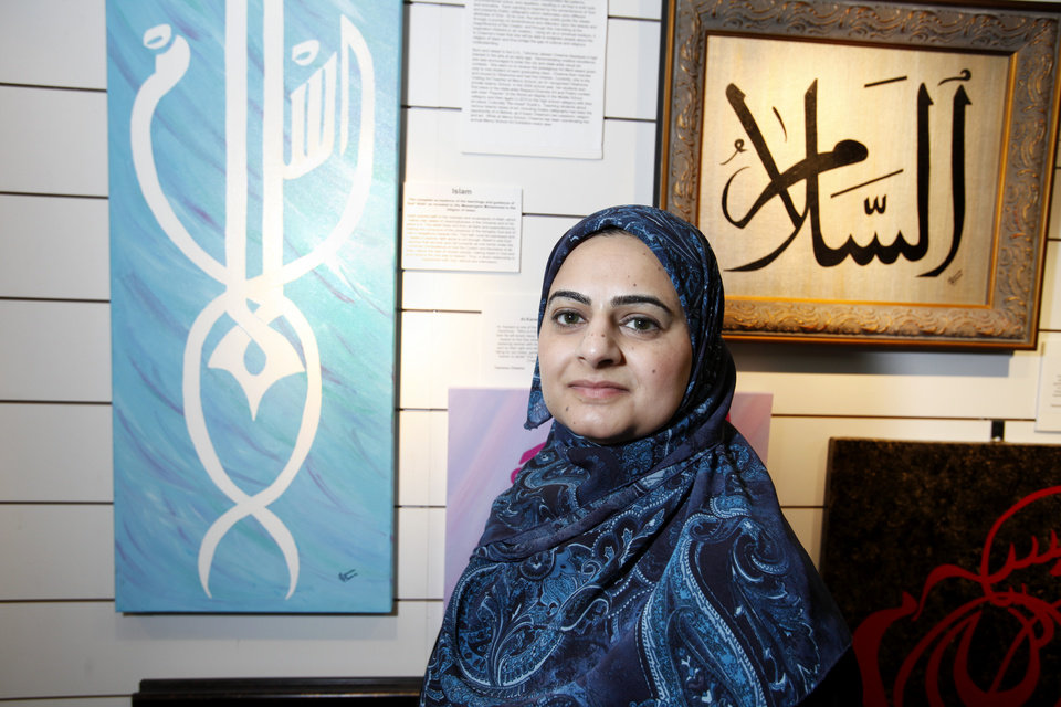 Islamic artist Tehmina Cheema poses with some of art at the Midwest City Library in Midwest City, Oklahoma August 19 , 2010. Photo by Steve Gooch, The Oklahoman