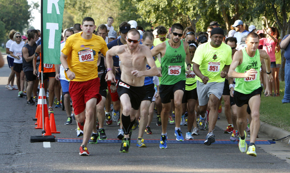 Photo -  Runners begin the 5k to Monet run last year in downtown Edmond. Photo by Paul Hellstern, The Oklahoman Archives   PAUL HELLSTERN -