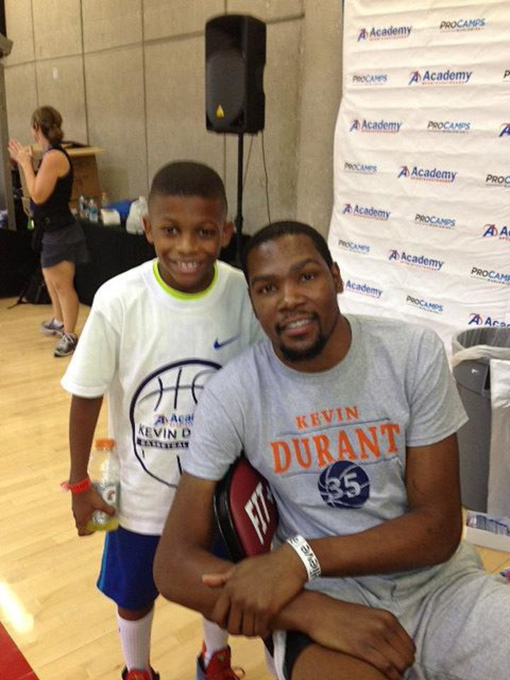 Photo - Eight-year-old Jay Fair meets with Kevin Durant. PHOTO PROVIDED