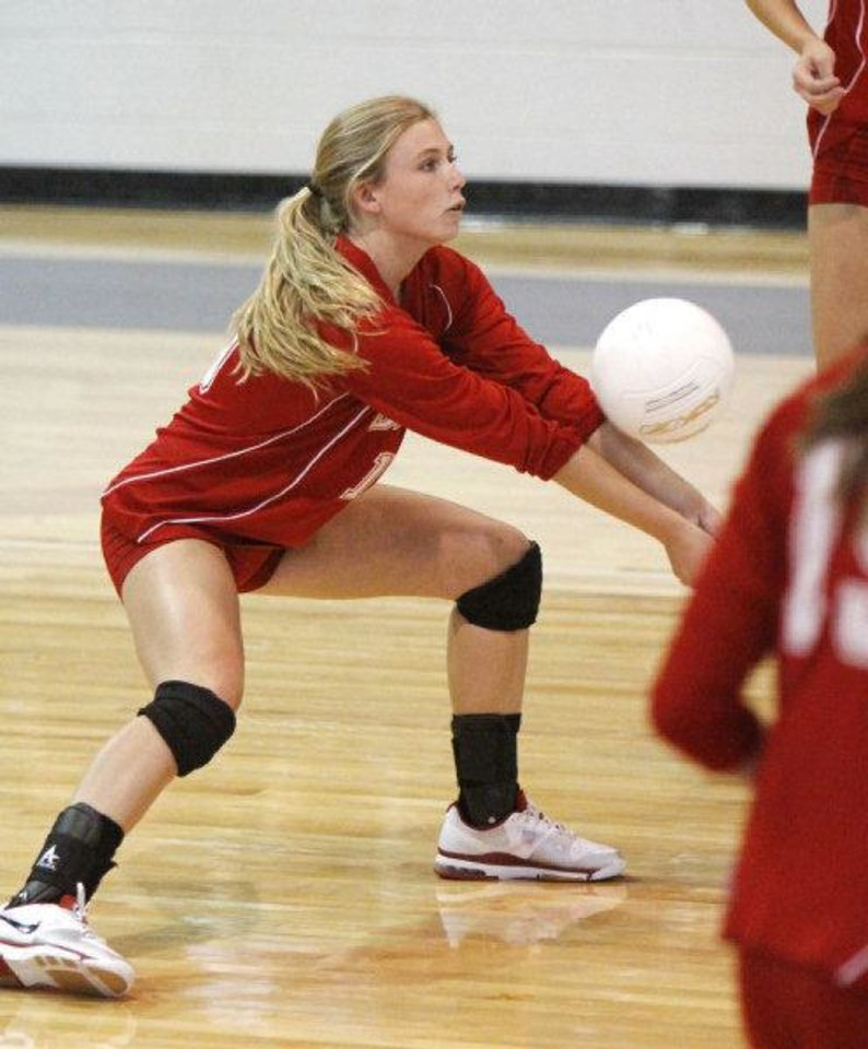 Photo - Cache player Brooklyn Sullins returns the ball to Oklahoma Christian in the Class 4A State Volleyball tournament at at Shawnee High School in Shawnee, OK, Friday, Oct. 7, 2011. By Paul Hellstern, The Oklahoman ORG XMIT: KOD