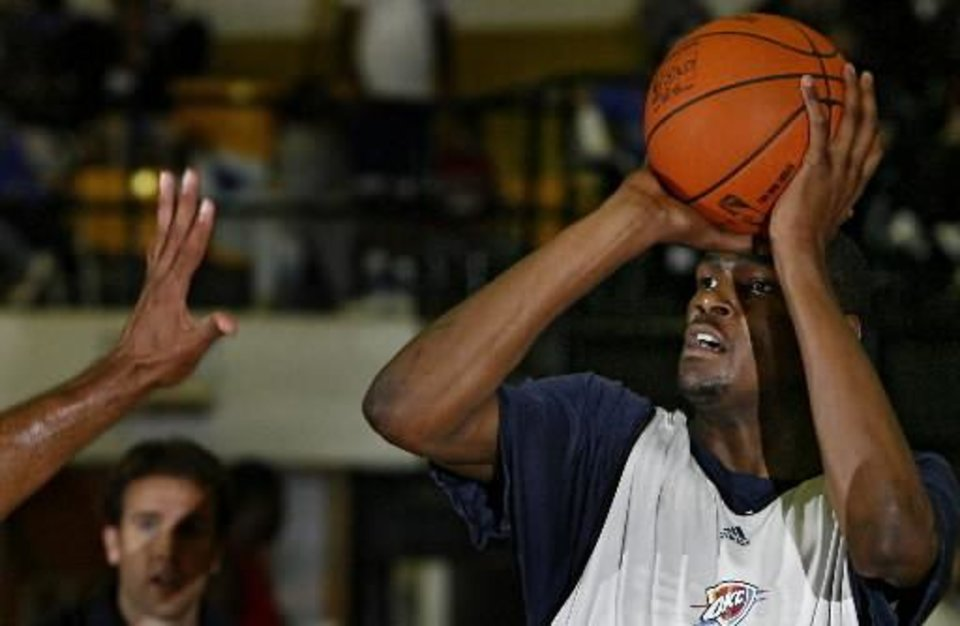 Photo -  Kevin  Durant lines up a shot over the defense during the Oklahoma City Thunder 2009 Community Practice at Midwest City High School on Monday, Oct. 6, 2009, in Midwest City, Okla. Photo by Chris Landsberger