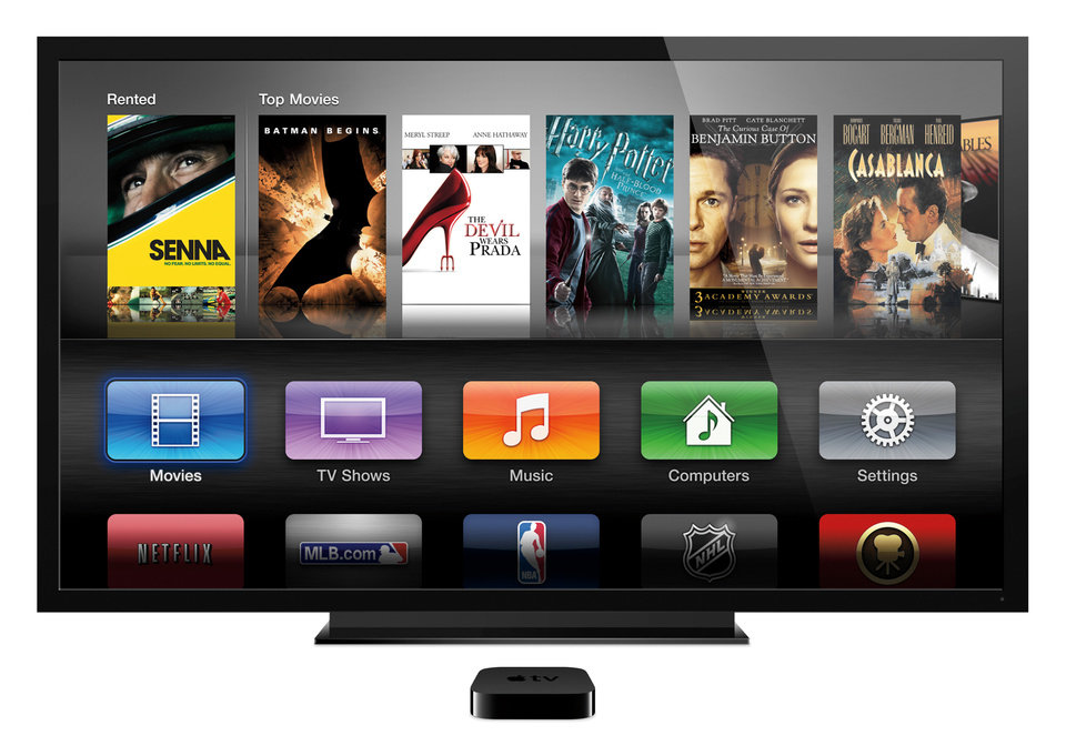Photo - This product image provided by Apple shows Apple TV. Apple and Amazon have ways to encourage you to buy more of their products: Offer bonus features that work only with gadgets from the same company. (AP Photo/Apple)