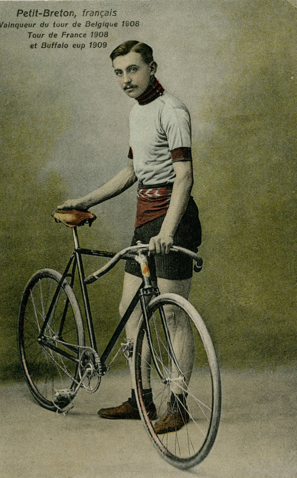 Photo - In this undated photo of a postcard provided by the WielerMuseum Roeselare, French cyclist and 1907 and 1908 Tour de France winner Lucien Petit-Briton stands with his bike. Three former winners of the Tour de France; Octave Lapize, Francois Faber and Lucien Petit-Breton all died fighting in World War I. Breton was the first rider to win the tour in two consecutive years. (AP Photo/Wielermuseum)